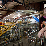 patrons on deschutes brewery tour in bottling facility 3