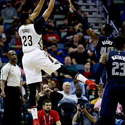 Dec 26, 2016; New Orleans, LA, USA;  New Orleans Pelicans forward Anthony Davis (23) shoots over Dallas Mavericks forward Harrison Barnes (40) during the second quarter of a game at the Smoothie King Center. Mandatory Credit: Derick E. Hingle-USA TODAY Sports