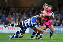 Nic Reynolds of London Welsh is tackled by David Sisi of Bath Rugby - Photo mandatory by-line: Patrick Khachfe/JMP - Mobile: 07966 386802 01/11/2014 - SPORT - RUGBY UNION - Bath - The Recreation Ground - Bath Rugby v London Welsh - LV= Cup