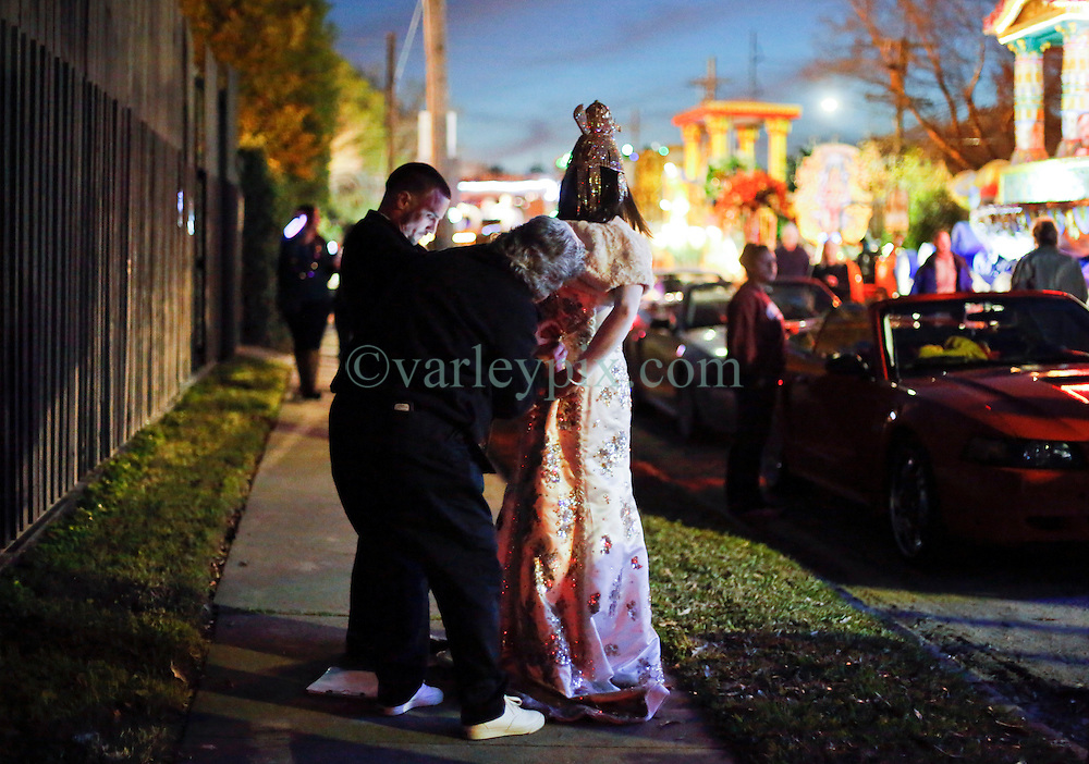 29 January 2016. New Orleans, Louisiana.<br /> The Krewe of Cleopatra kicks off the main parading season of Mardi Gras in New Orleans with floats filled with riders dispensing beads and throws, marching bands and dance troupes. Families line the streets Uptown to cheer on Cleopatra - 'Throw me something Mister!'<br /> Photo&copy;; Charlie Varley/varleypix.com
