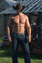 shirtless cowboy stud on a ranch showing off his body