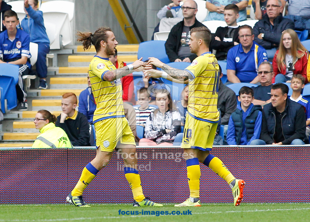 Stevie May (L) celebrates the first goal for Sheffield Wednesday during the Sky Bet Championship match at the Cardiff City Stadium, Cardiff<br /> Picture by Mike  Griffiths/Focus Images Ltd +44 7766 223933<br /> 27/09/2014