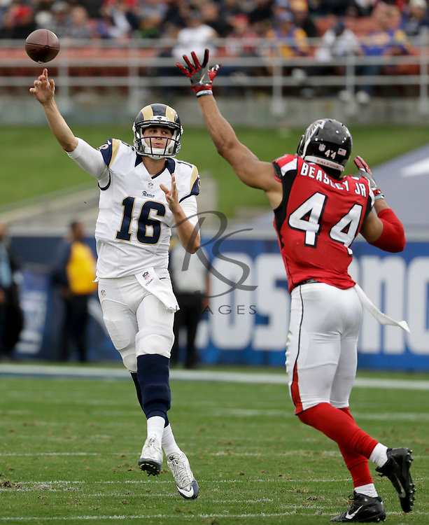 Los Angeles Rams quarterback Jared Goff, left, throws under pressure from Atlanta Falcons outside linebacker Vic Beasley during the first half of an NFL football game Sunday, Dec. 11, 2016, in Los Angeles. (AP Photo/Rick Scuteri)