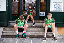Waowdeals Pro Cycling get lost in their phones at Giro Rosa 2018 - Team Presentation in Verbania, Italy on July 5, 2018. Photo by Sean Robinson/velofocus.com
