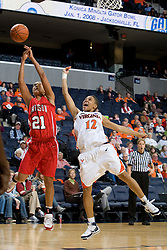 Virginia guard Britnee Millner (12) and Davidson forward Mercedes Robinson (21) fight for a loose ball.  The Virginia Cavaliers women's basketball team defeated the Davidson Wildcats 83-68 at the John Paul Jones Arena in Charlottesville, VA on December 20, 2007.