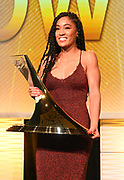 Dec 20, 2018; San Antonio, TX, USA; Women's 2010 winner Queen Harrison of Virginia Tech poses with the Bowerman Trophy at the 10th Bowerman Awards at the JW Marriott San Antonio Hill Country Resort & Spa.