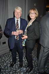 STANLEY JOHNSON and his wife JENNIFER at a party to celebrate the publication of Thenford: The Creation of an English Garden by Michael & Anne Heseltine held at The Grosvenor House Hotel, Park Lane, London on 24th October 2016.
