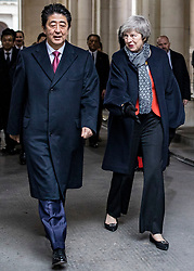 © Licensed to London News Pictures. 10/01/2019. London, UK. Prime Minister Theresa May (R) and Prime Minister of Japan Shinzo Abe (L) walk to Downing Street ahead of a bilateral meeting. Photo credit: Rob Pinney/LNP