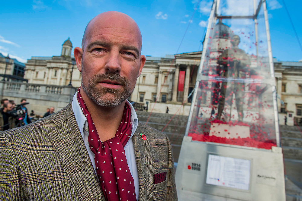 Artist Mark Humphrey - The Every Man Remembered sculpture in Trafalgar Square unveiled by Royal British Legion beneficiary Serena Alexander - Serena lost her son, Sam Alexander MC, in Afghanistan and received help through the Legion's Independent Inquest Advice Service. Her links to the First World War are extensive and she is helping to promote the Every Man Remembered website. Her own Great Uncle, Norman Birtwistle MC was awarded the Military Cross before being killed in action during one of the last cavalry charges in 1918. The sculpture is a collaborative piece with the artist Mark Humphrey - being 7.5-metre high it will sit in Trafalgar Square until 16 November. Made of brass, it is loosely based on the Unknown Solider and stands on a plinth of limestone sourced from the Somme. It is encased in a Perspex obelisk, surrounded by poppies which float up around the figure every five minutes.  The sculpture will carry out a four-year tour of Great Britain, visiting a number of different locations across the country where members of the public will be invited to remember all those who fell during the First World War.