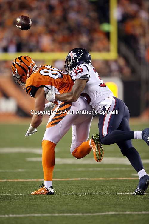 Houston Texans defensive back Eddie Pleasant (35) breaks up a pass intended for Cincinnati Bengals tight end Tyler Eifert (85) during the 2015 week 10 regular season NFL football game against the Houston Texans on Monday, Nov. 16, 2015 in Cincinnati. The Texans won the game 10-6. (©Paul Anthony Spinelli)