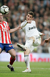 MADRID, SPAIN - Sunday, March 28, 2010: Real Madrid Club de Futbol's Gonzalo Higuain in action against Club Atletico de Madrid during the La Liga Primera Division Madrid Derby match at the Estadio Santiago Bernabeu. (Pic by Hoch Zwei/Sprimont Press/Propaganda)