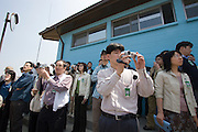 Panmunjom. Japanese tour group visiting the border to North Korea.