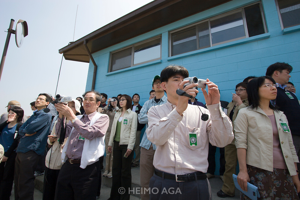 Panmunjom. Japanese tour group visiting the border to North Korea.