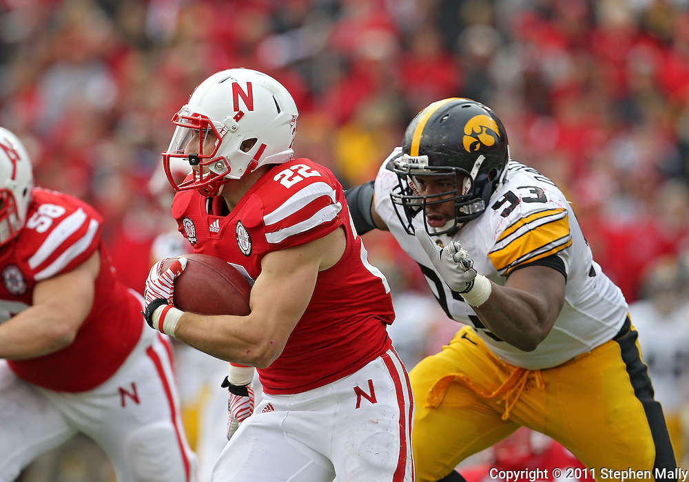 November 25, 2011: Iowa Hawkeyes defensive lineman Mike Daniels (93) closes in on Nebraska Cornhuskers running back Rex Burkhead (22) on a run during the second half of the NCAA football game between the Iowa Hawkeyes and the Nebraska Cornhuskers at Memorial Stadium in Lincoln, Nebraska on Friday, November 25, 2011. Nebraska defeated Iowa 20-7.