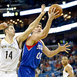Nov 16, 2013; New Orleans, LA, USA; Philadelphia 76ers center Spencer Hawes (00) shoots over New Orleans Pelicans center Jason Smith (14) during the first quarter of a game at New Orleans Arena. Mandatory Credit: Derick E. Hingle-USA TODAY Sports