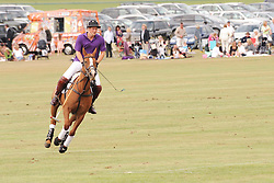 Asprey World Class Cup polo held at Hurtwood Park Polo Club, Ewhurst, Surrey on 17th July 2010.<br /> Picture shows:- HRH PRINCE HARRY wearing purple shirt nr1