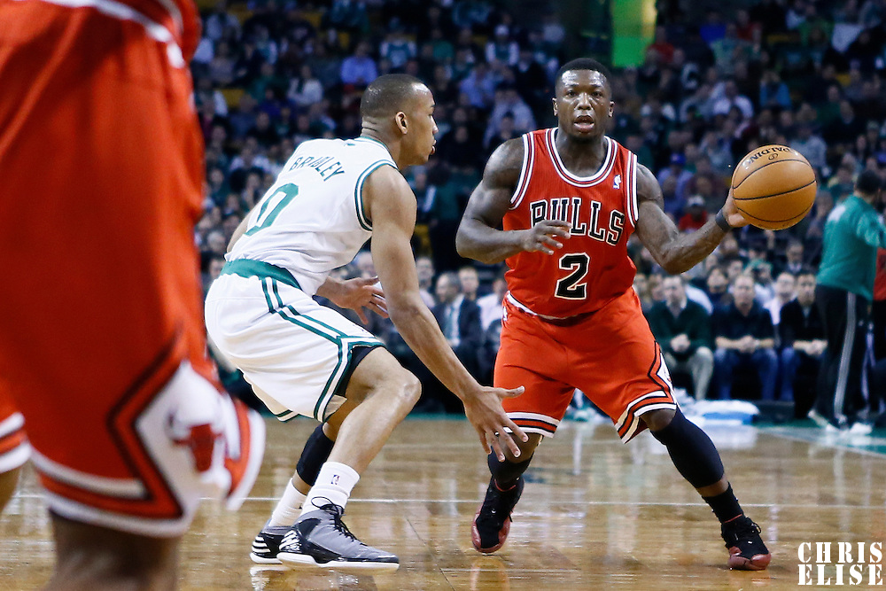 13 February 2013: Chicago Bulls point guard Nate Robinson (2) passes the ball over Boston Celtics point guard Avery Bradley (0) during the Boston Celtics 71-69 victory over the Chicago Bulls at the TD Garden, Boston, Massachusetts, USA.
