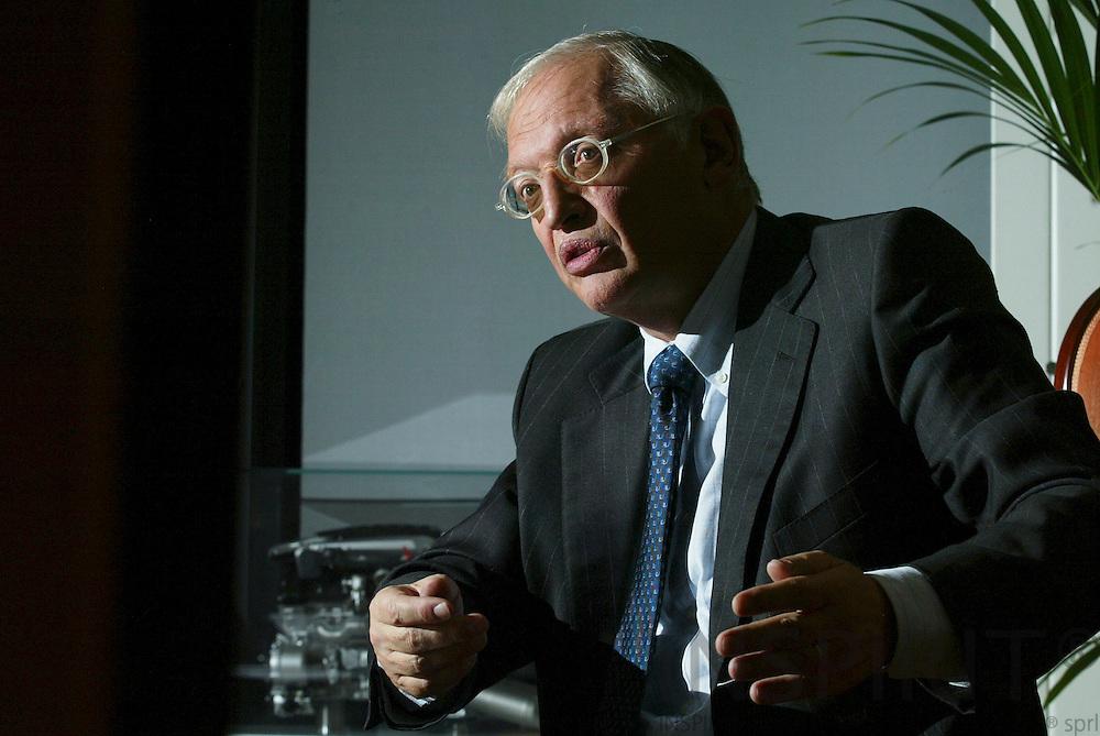 BRUSSELS - BELGIUM - 30 OCTOBER 2006 -- EU Commissioner Günther VERHEUGEN in his office.   PHOTO: ERIK LUNTANG /