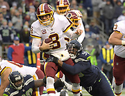 Nov 5, 2017; Seattle, WA, USA; Washington Redskins quarterback Kirk Cousins (8) is sacked by Seattle Seahawks defensive tackle Quinton Jefferson (99) during an NFL football game at CenturyLink Field. The Redskins defeated the Seahawks 17-14.