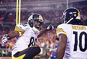 Pittsburgh Steelers wide receiver Darrius Heyward-Bey (88) celebrates wildly after Pittsburgh Steelers wide receiver Martavis Bryant (10) makes a sensational catch on a third quarter touchdown pass reception that gives the Steelers a 15-0 lead during the NFL AFC Wild Card playoff football game against the Cincinnati Bengals on Saturday, Jan. 9, 2016 in Cincinnati. The Steelers won the game 18-16. (©Paul Anthony Spinelli)