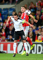 Sam Vokes of Wales challenges for a header with Julian Baumgartlinger of Austria - Mandatory by-line: Dougie Allward/JMP - 02/09/2017 - FOOTBALL - Cardiff City Stadium - Cardiff, Wales - Wales v Austria - FIFA World Cup Qualifier 2018
