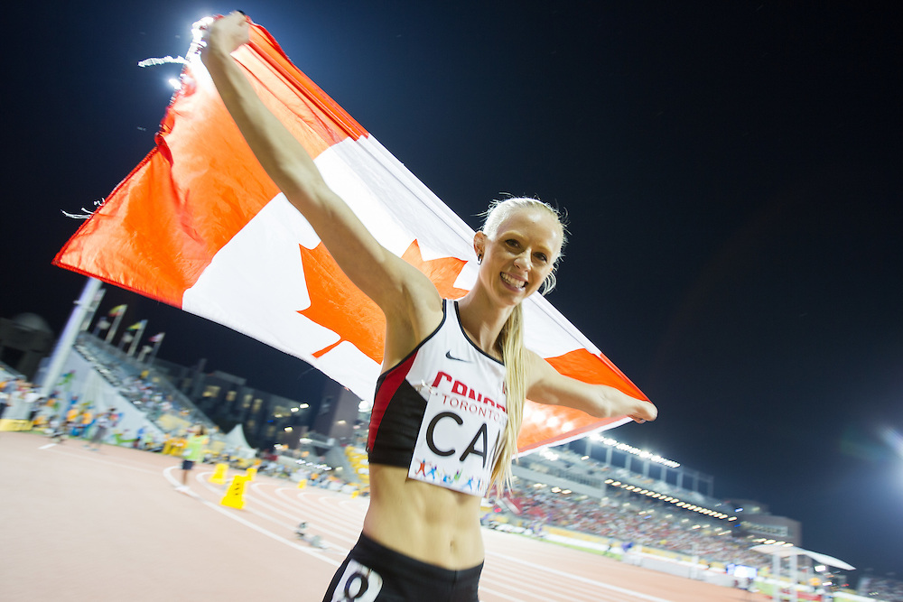 Canadian 4X400 metre team member Sage Watson celebrates her team's bronze medal win at the 2015 Pan American Games at CIBC Athletics Stadium in Toronto, Canada, July 25,  2015.  AFP PHOTO/GEOFF ROBINS