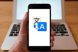 Using iPhone smartphone to display logo of Google Translate online translation service