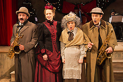 "© Licensed to London News Pictures. 28/11/2014. London, England. L-R: Toby Aitor Basauri, Petra Massey, Toby Park and Sophie Russell. Spymonkey company present ""Mrs Hudson's Christmas Corker! Or 'Your Goose is Cooked Mr Holmes' ..."" at Wilton's Music Hall, London. Written by Barry and Boy Cryer, the Christmas show takes place at 221B Baker Street with a tale based on the Sherlock Holmes legend by Sir Arthur Conan Doyle. Performances from 2 to 31 December 2014. With actors: Aitor Basauri (Dr Watson), Petra Massey (Mrs Hudson), Toby Park (Sherlock Holmes) and Sophie Russell. Photo credit: Bettina Strenske/LNP"