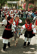 """Cavalcata Sarda, Sassari på Sardinia.neg In Sardinia there are more than 200 festivals and events during the year, but only 3 offer the opportunità to see united, un the same place, all the traditional customs of the isle: Sant'Efisio at Cagliari, the Redentore at Nuoro and the Cavalcata Sarda at Sassari.<br /> The Cavalcata, that is different from the other two celebration because it's not a religious celebration, it join varoius aspects of celebration: there is the presentation of the customs then there is one component more sportive with skills by the riders (""""pariglie""""), elements typically of folk-lore: songs and dances tha last until late hour."""