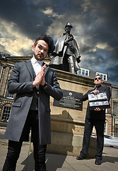!!!! FREE TO USE !!!! !!!! FREE TO USE !!!! !!!! FREE TO USE !!!! <br /> <br /> Pictured: Colin Cloud, the real life Sherlock Holmes, pays a visit to the Sherlock Holmes statue, Picardy Place, Edinburgh, Scotland.<br /> <br /> Colin Cloud: One hundred thousand pounds &ndash; and a dare.<br /> <br /> &ldquo;If your Majesty would condescend to state your case,&rdquo; he remarked, &ldquo;I should be better able to advise you.&rdquo;<br /> <br /> The man sprang from his chair and paced up and down the room in uncontrollable agitation. Then, with a gesture of desperation, he tore the mask from his face and hurled it upon the ground.<br /> <br /> &ldquo;You are right,&rdquo; he cried; &ldquo;I am the King. Why should I attempt to conceal it?&rdquo;<br /> <br /> - A Scandal in Bohemia, Arthur Conan Doyle. The Strand Magazine. July 1891<br /> <br /> This is how Sherlock Holmes surprises his masked visitor by identifying him as the disguised Wilhelm Gottsreich Sigismond von Ormstein, Grand Duke of Cassel-Felstein &ndash; the hereditary King of Bohemia &ndash; in Arthur Conan Doyle&rsquo;s A Scandal in Bohemia. <br /> <br /> After two novels, this was the first of 56 short stories featuring the great fictional detective, and features some of the best remembered elements of the legend of Sherlock Holmes: a noble client, disguises, clever tricks, a case that&rsquo;s not quite as it seems, and The Woman, Irene Adler, who bested Sherlock Holmes with clever tricks and disguises of her own.<br /> <br /> The game is afoot!<br /> <br /> Leap ahead 126 years to where 2017&rsquo;s real life Sherlock Holmes, Colin Cloud, brings a touch of Scandal to his new Edinburgh Festival Fringe show: Dare.<br /> <br /> Like A Scandal in Bohemia, the recurring theme of Dare is masks and disguises. <br /> <br /> Take the dare<br /> <br /> In Dare, Colin Cloud asks: how much of our lives on social networks are real? How much of our online lives is a disguise?<br /> <br /> Dare&rsquo;s audiences are given the chance to hide their identity &ndash; and then to speak out, to say whatever they feel or recall their most daring tweet.<br /> <br /> But in exchange for that truth, they must take the dare &ndash; submitting to Cloud's unerring mind-readi