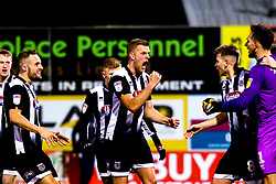 Grimsby Town players celebrate at full time - Mandatory by-line: Ryan Crockett/JMP - 04/01/2020 - FOOTBALL - One Call Stadium - Mansfield, England - Mansfield Town v Grimsby Town - Sky Bet League Two