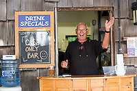 A happy, enthusiastic senior greets visitors at the Filberg Tea House open during the annual Filberg Festival.  Comox, The Comox Valley, Vancouver Island, British Columbia, Canada.
