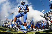 Kentucky football players take the field before a game against Florida at Commonwealth Stadium. (Photo by Joe Robbins)