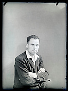vintage formal studio portrait of adult man, circa 1930s