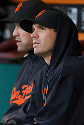 May 24, 2011; San Francisco, CA, USA;  San Francisco Giants starting pitcher Barry Zito (front) sits next to left fielder Pat Burrell (back) in the dugout during the third inning against the Florida Marlins at AT&T Park. Florida defeated San Francisco 5-1.