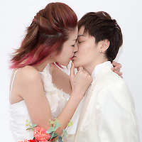 Two  women  celebrate union  during wearing mariages clothes during rainbow pride at Shibuya