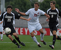Ohio State forward Kenny Cunningham (25) fights for possession against Binghamton defender Kevin Bunce (25) and forward Luke Halberg (9) as OSU takes on Binghamton in the first half of an NCAA men's college soccer game in Columbus, Ohio on Sunday, Sept. 11, 2011, at Jesse Owens Memorial Stadium.