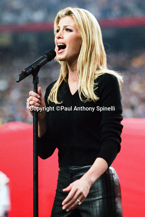 Singer performer Faith Hill sings the National Anthem before the St. Louis Rams NFL Super Bowl XXXVI football game against the Tennessee Titans on Jan. 30, 2000 in Atlanta. The Rams won the game 23-16. (©Paul Anthony Spinelli)