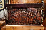 Late 1800s bentwood chest by Captain Carpenter (Heiltsuk) of British Columbia, shown in Alaska State Museum, Juneau, USA. The City and Borough of Juneau is the capital city of Alaska and the second largest city in the USA by area (only Sitka is larger). This unified municipality lies on Gastineau Channel in the Alaskan panhandle. Juneau has been the capital of Alaska since 1906, when the government of what was the District of Alaska was moved from Sitka. The city is named after a gold prospector from Quebec, Joe Juneau. Isolated by rugged terrain on Alaska's mainland, Juneau can only be reached by plane or boat. Downtown Juneau sits at sea level under steep mountains up to 4000 feet high, topped by Juneau Icefield and 30 glaciers.