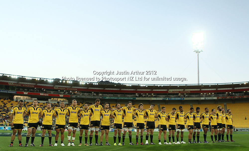Hurricanes players stand for a minute silence during the 2012 Super Rugby season, Hurricanes v Highlanders at Westpac Stadium, Wellington, New Zealand on Saturday 17 March 2012. Photo: Justin Arthur / Photosport.co.nz