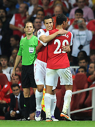 28.09.2011, Emirates Stadium, London, ENG, UEFA CL, Gruppe F, FC Arsenal (ENG) vs Olympiakos Piräus (GRE), im Bild Arsenal's Robin Van Persie replaces team-mate Marouane Chamakh // during the UEFA Champions League game, group F, ENG, UEFA CL, FC Arsenal (ENG) vs Olympiakos Piräus (GRE) at Emirates Stadium in London, United Kingdom on 2011/09/28. EXPA Pictures © 2011, PhotoCredit: EXPA/ Propaganda Photo/ Chris Brunskill +++++ ATTENTION - OUT OF ENGLAND/GBR+++++