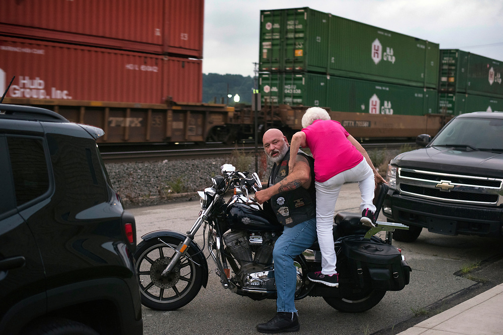 Homestead Mayor Betty Esper climbs on T-Ranchula's Harley Davidson before their entrance at Brawl Under the Bridge wrestling match in Homestead.