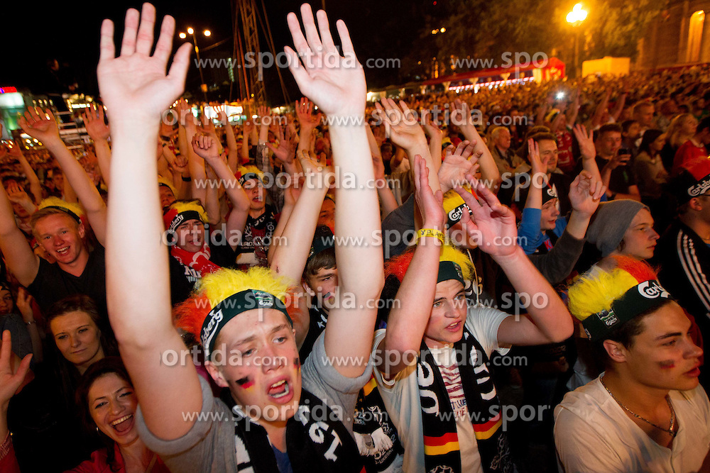 Supporters of Germany celebrate at Fan zone in the City centre during the UEFA EURO 2012 match between Germany and Portugal on June 9, 2012 in Fan zone Warsaw, Poland.  (Photo by Vid Ponikvar / Sportida.com)