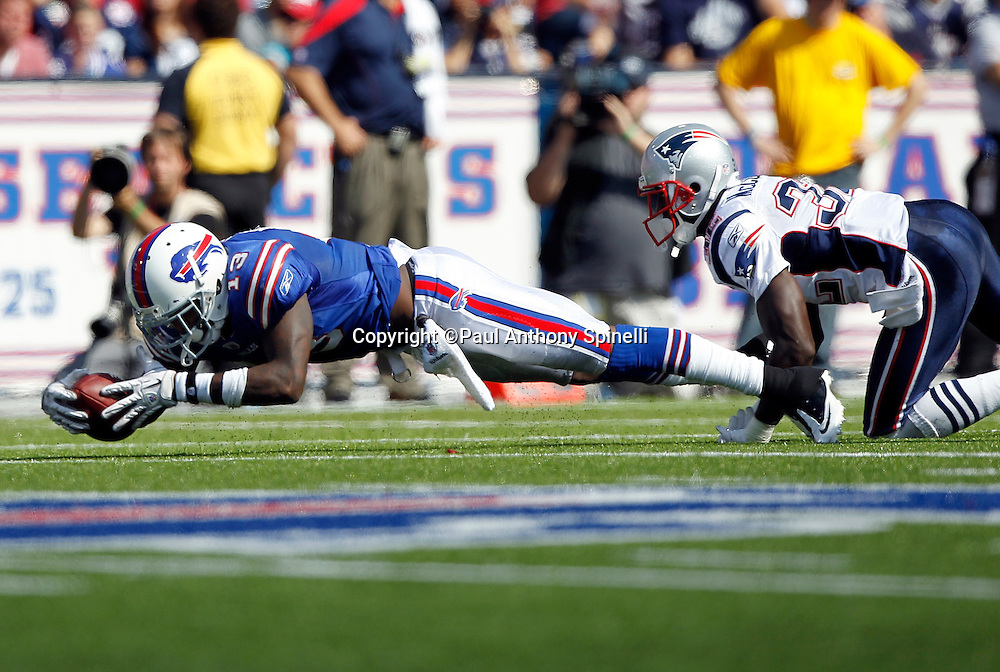 Buffalo Bills wide receiver Steve Johnson (13) dives for extra yardage after catching a pass during the NFL week 3 football game against the New England Patriots on Sunday, September 25, 2011 in Orchard Park, New York. The Bills won the game 34-31. ©Paul Anthony Spinelli