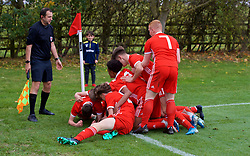 WREXHAM, WALES - Wednesday, October 30, 2019: Wales' Kai Ludvigsen celebrates scoring the first goal with team-mates during the 2019 Victory Shield match between Wales and Republic of Ireland at Colliers Park. (Pic by David Rawcliffe/Propaganda)
