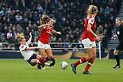 Rachel Furness tackles Lia Walti during the FA Women's Super League match between Tottenham Hotspur Women and Arsenal Women FC at Tottenham Hotspur Stadium, London, United Kingdom on 17 November 2019.