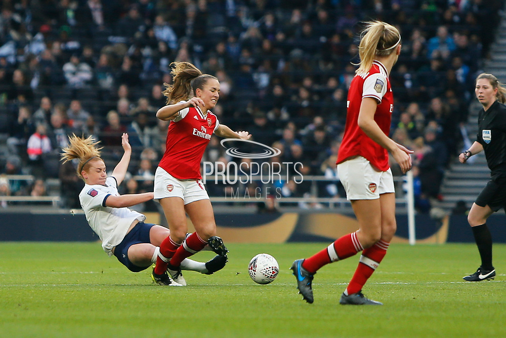 Rachel Furness tackles Lia Walti during the FA Women's Super League match between Tottenham Hotspur Women and Arsenal Women FC at Tottenham Hotspur Stadium, London, United Kingdom on 17 November 2019.