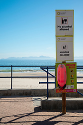 """Bikini Beach, in Gordon's Bay in the Western Cape, South Africa, on Saturday, April 18, 2020. The South African government has shut down the country, in response to Coronavirus, asking everyone but essential workers to stay home. The signs that say: """"No alcohol allowed"""" and """"No dogs allowed"""" are permanent fixtures. But they ring especially true right now as South Africans are not allowed to buy alchol or walk their dogs. PHOTO: EVA-LOTTA JANSSON<br /> [This is one is a series of landscapes shot in the Western Cape, South Africa, during the national ockdown in response to the Coronavirus.]"""
