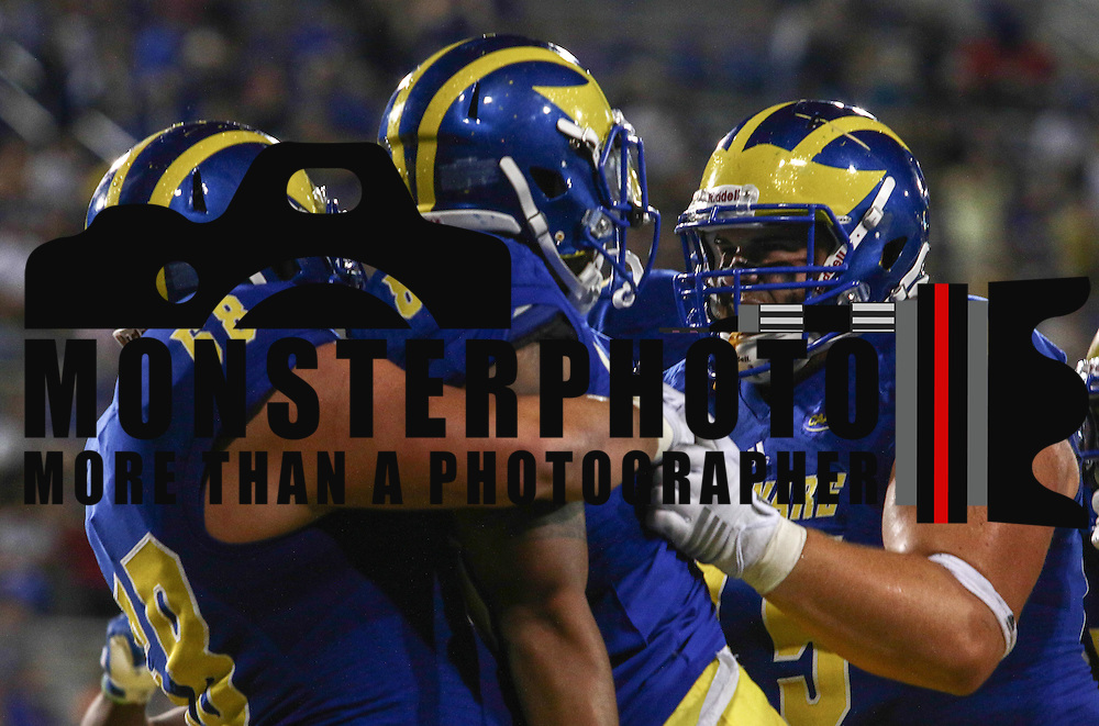Delaware wide receiver DIANTE CHERRY (80) celebrates with teammates after scoring a touch down during a week one game between the Delaware Blue Hens and the Delaware State Hornets, Thursday, Sept. 01, 2016 at Tubby Raymond Field at Delaware Stadium in Newark, DE.