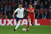 Lucia Bronze (2) of England and Natasha Harding (7) of Wales battle for possession during the FIFA Women's World Cup UEFA Qualifier match between England Ladies and Wales Women at the St Mary's Stadium, Southampton, England on 6 April 2018. Picture by Graham Hunt.